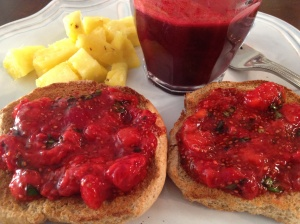 Fruit, juice, and strawberry-basil jam on whole wheat toast: Breakfast of champions.
